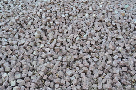 Background made of a closeup of a pile of crushed square stone. Imagens