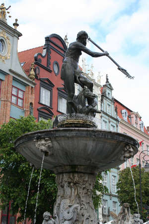Neptune Fountain and the Townhall in Gdansk Poland photo