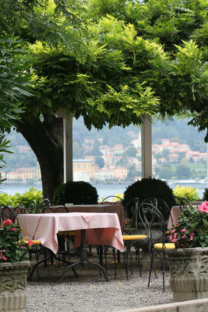 Restaurant table outdoors along the lake como photo