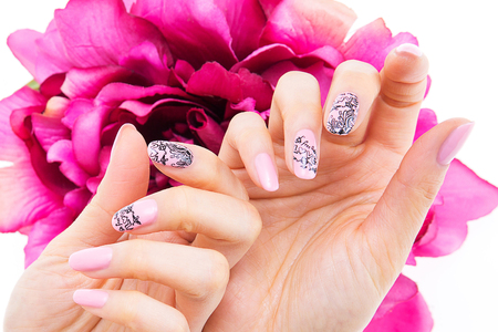 a womans nail, designed with nail art Stock Photo