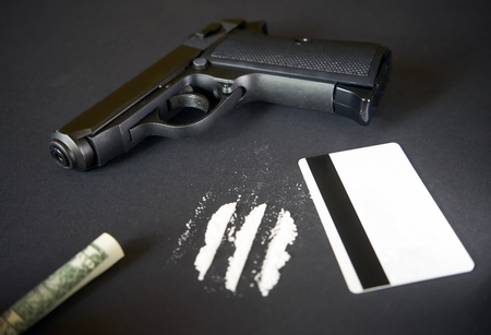 Credit card, gun, road of cocacine, money, ammunition, gun