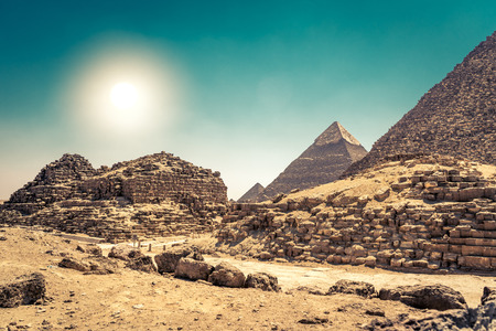 Egyptian pyramids in sand desert and clear sky. Stock Photo