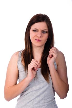 molesto: joven y bella mujer mirando disgustado Foto de archivo