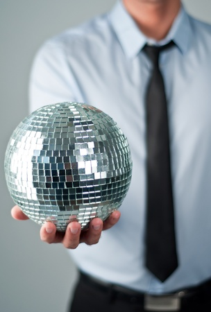 profit celebration: business man with mirror ball Stock Photo