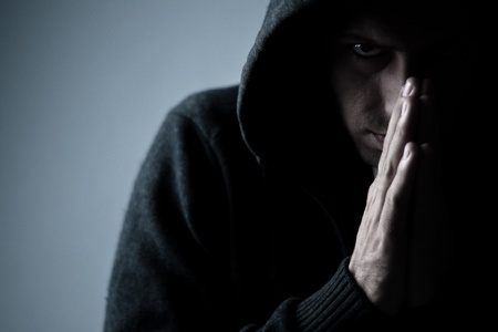 scary person with praying hands photo