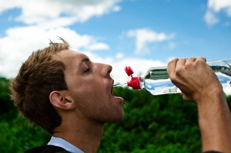 young man drinking water photo