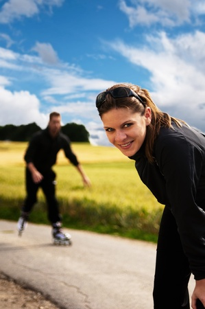 inline skating: young sporty woman having a break