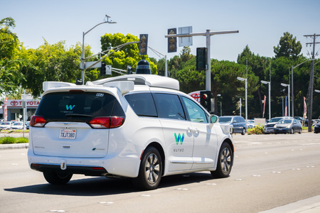 self testing: August 6, 2017 Mountain ViewCaUSA - Waymo self driving car cruising on a street, Silicon Valley