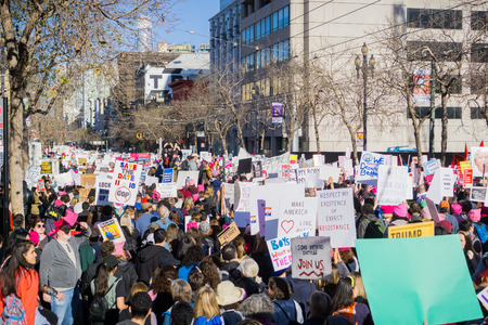 January 20, 2018 San Francisco  CA  USA - Crowds of people turned out for the Womens March; People marching on Market street in downtown