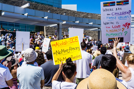 June 30, 2018 San Jose  CA  USA - People holding up signs with Families belong together and Abolish ICE at the rally held in front of the City Hall, in downtown San Jose Editorial