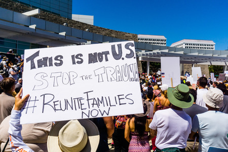 June 30, 2018 San Jose  CA  USA - This is not U.S., Stop the trauma, #reunitefamiliesnow  sign raised at the Families belong together rally held in front of the City Hall, in downtown San Jose Editorial