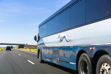 Los Banos  CA  USA - Greyhound bus driving north on I5 interstate towards San Francisco