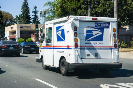 Sunnyvale  CA  USA - USPS vehicle driving on a busy street in south San Francisco bay area Editorial