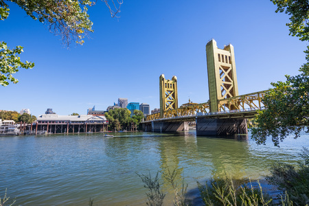 September 23, 2018 Sacramento / CA / USA - View towards the Tower Bridge and the Sacramento river shoreline; the downtown skyscrapers visible in the background
