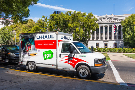 September 22, 2018 Sacramneto / CA / USA - U-Haul van parked in the downtown area, in front of the California Capitol State building Editorial