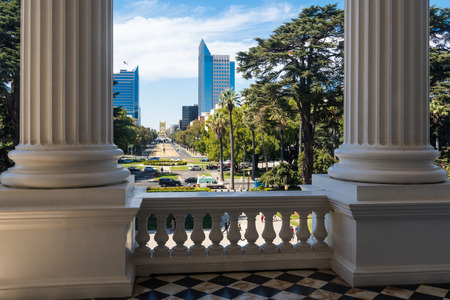 September 22, 2018 Sacramento / CA / USA - View of the Capitol Mall taken from the historical California State Capitol building; Colonnade and balcony ledge visible in the foreground;
