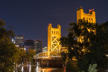 Night view of the Tower Bridge connecting Sacramento to West Sacramento; downtown area skyline visible in the background; California Stock Photo