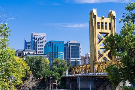 View towards the Tower Bridge and the skyscrapers in downtown Sacramento on a sunny day; California Stock Photo