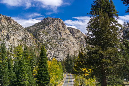 Driving through the Sierra mountains towards Sonora pass on a sunny autumn day, California