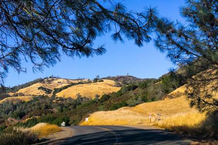Road through Mt Diablo State Park, the summit and golden hills visible in the backgammon, Contra Costa county, San Francisco bay, California
