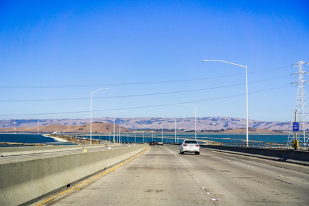 Travelling on Dumbarton bridge towards east San Francisco bay area, Silicon Valley, California