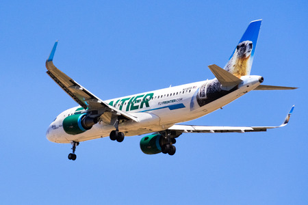 September 11, 2018 San Jose / CA / USA - Flying Frontier Airlines aircraft approaching Norman Y. Mineta San Jose International Airport and preparing for landing; blue sky background Editorial