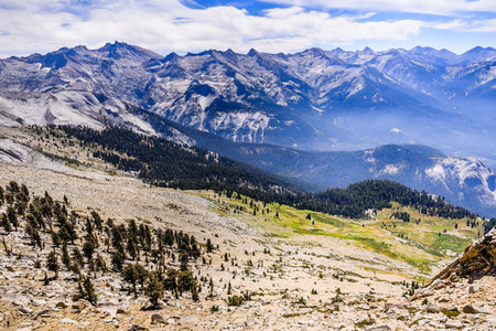 Alpine landscape and view towards eastern Sierra Nevada mountains as seen from Alta Peak on a sunny summer day; Sequoia National Park, California Stock fotó