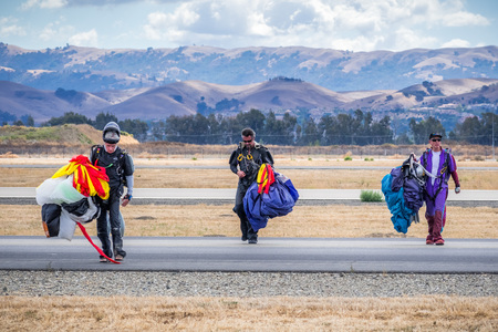 October 6, 2018 Livermore  CA  USA - Team of parachutists after landing a jump; Livermore Municipal Airport Open House event; east San Francisco bay area