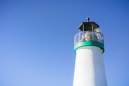 Top of the Santa Cruz Breakwater Lighthouse, Walton Lighthouse, Santa Cruz, California; blue sky background Stock fotó
