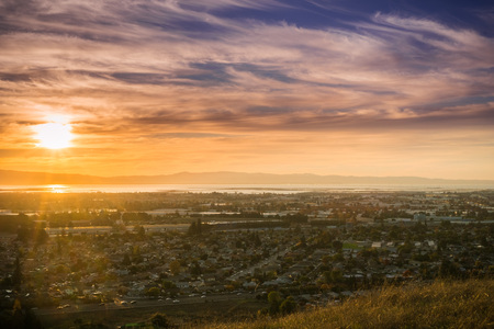 Sunset view of Hayward and Union City from Garin Dry Creek Pioneer Regional Park, east San Francisco bay shoreline and San Mateo bridge in the background, California Stock Photo - 112489224
