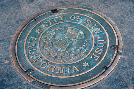 December 7, 2017 San Jose / California / USA: Close up of a City of San Jose Manhole Cover on the sidewalk in the downtown area