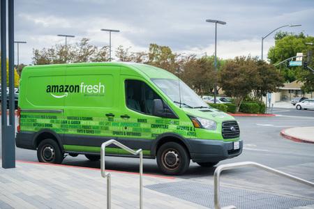 November 8, 2017 San JoseCAUSA - Amazon Fresh van making deliveries in San Francisco bay area