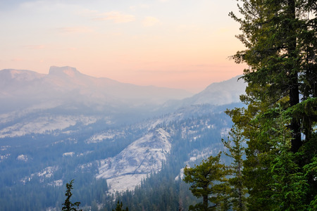 Sunrise landscape in Yosemite National Park; low visibility due to the smoke from the Ferguson Fire present in the air; California