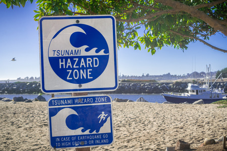 Standard Tsunami Hazard Zone warning sign on the Pacific Ocean coast, Santa Cruz, California