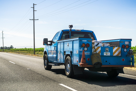 July 17, 2018 Gilroy  CA  USA - PG&E service vehicle driving on the freeway Editorial