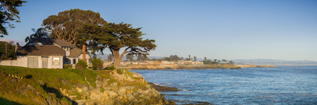 Panoramic view of the rugged Pacific Ocean coast on a sunny evening near  Santa Cruz, California
