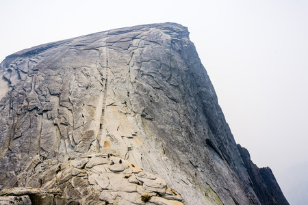 Going up on the Half Dome cables on a summer day; smoke from Ferguson Fire present in the air; Yosemite National Park, California
