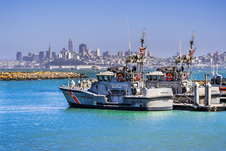 June 29, 2018 Sausalito  CA  USA - US Coast Guard boats at the Golden Gate station; the San Franciscos financial district skyline visible in the background