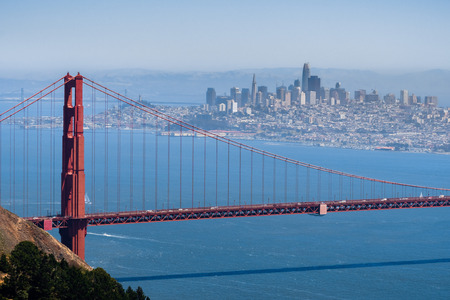 Aerial view of Golden Gate Bridge; the San Francisco skyline visible in the background; California