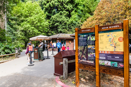 August 10, 2018 Mill Valley  / CA / USA - Information panels and rangers welcoming visitors to Muir Woods National Monument, the Visitor Center building visible in the background; San Francisco bay