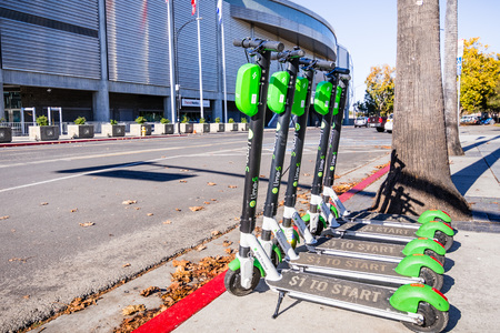 November 25, 2018 San Jose  CA  USA - Lime Scooters lined up on a sidewalk in downtown San Jose, south San Francisco bay area Editorial