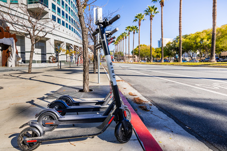 November 25, 2018 San Jose  CA  USA - Bird Electric Scooters lined up on a sidewalk in downtown San Jose, south San Francisco bay area