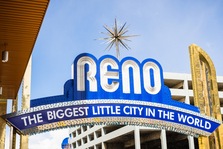March 25, 2018 Reno  Nevada  USA - The Reno arch on a sunny but moody day, with light snow falling from passing clouds