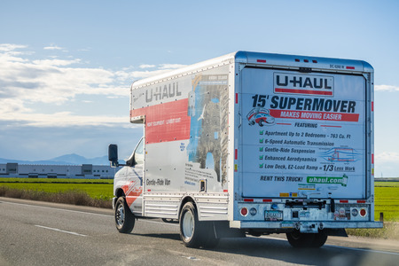 March 25, 2018 Stockton / CA / USA - U-Haul van travelling on the interstate; U-Haul is an American company offering DIY moving solutions