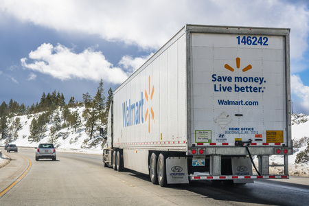 March 25, 2018 Truckee  CA  USA - Walmart truck driving on the interstate through the Sierra mountains