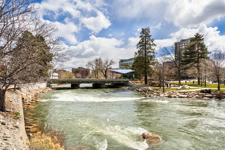 Reno, Nevada skyline as seen from the shoreline of Truckee river flowing through downtown Stock Photo