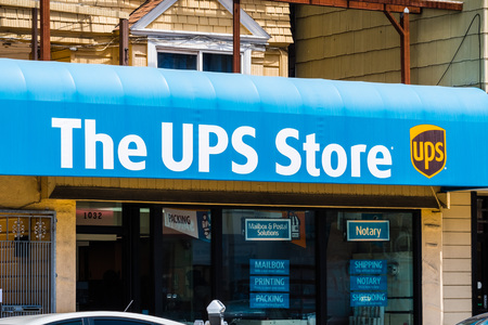 July 20, 2018 San Francisco  CA  USA - The UPS store logo placed above the to one of their city locations