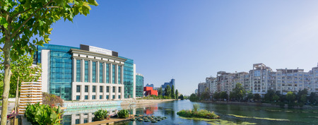 September 18, 2017 Bucharest/Romania - The modern National Library of Romania on the shoreline of Dambovita River on a sunny clear day