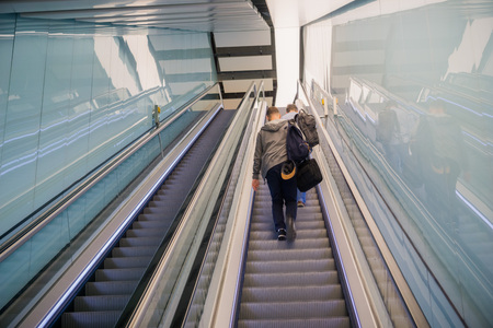 People riding an escalator at Heathrow Airport