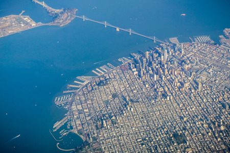 San Francisco financial district and the Bay Bridge as seen from an airplane on a clear sunny day